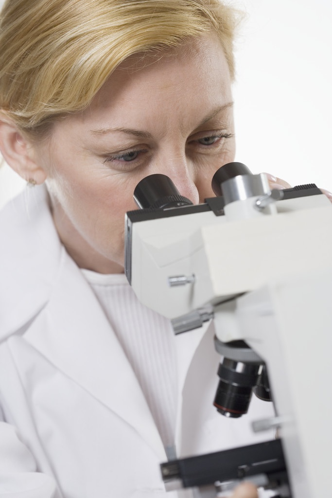 Lab Technician Using Microscope