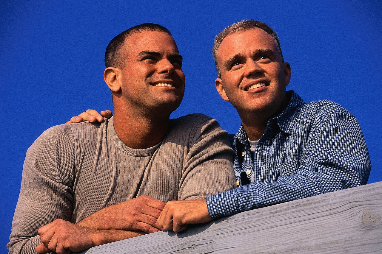 Gay Couple Leaning on a Railing