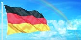 6726675-german-flag-on-beautiful-sky-background